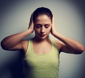 stock photo of confuse  - Confusion unhappy thinking woman with headache on dark background - JPG