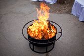 pic of cozy hearth  - Fire in a fireplace in the wedding celebration outdoor  - JPG