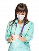 stock photo of female mask  - Female doctor wearing surgical mask isolated on white - JPG