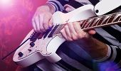 picture of guitar  - Young Male Musician With A White Guitar - JPG
