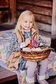 image of country girl  - happy blonde child girl playing with easter decorations at country house in spring - JPG