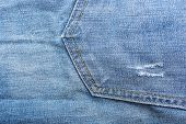 stock photo of denim jeans  - Fragment of material jeans denim texture background - JPG