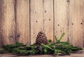 image of bump  - christmas tree branches with bumps on wooden background - JPG