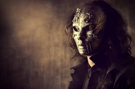 foto of steampunk  - Portrait of a mysterious man in iron mask - JPG