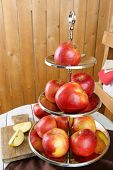 image of serving tray  - Tasty ripe apples on serving tray on table on wooden background - JPG