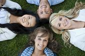 stock photo of late 20s  - A diverse group of college students smiling and having fun together - JPG