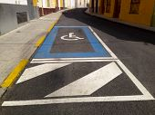 stock photo of crippled  - Disabled parking sign place on old downtown steet - JPG
