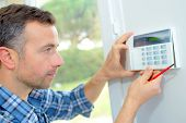 picture of dial pad  - Electrician fitting an intrusion alarm - JPG