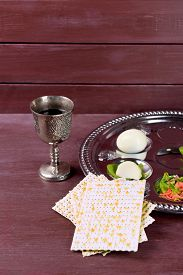 stock photo of seder  - Matzo for Passover with Seder meal with wine on wooden background - JPG