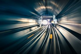 foto of opposites  - Subway tunnel with blurred light tracks with arriving train in the opposite direction  - JPG