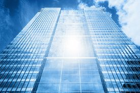 stock photo of high-rise  - Sun reflecting in a usual modern business skyscraper - JPG