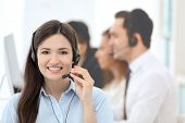 Female call center operator working in office poster