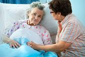 image of geriatric  - Senior female is being visited by the daughter in hospital - JPG