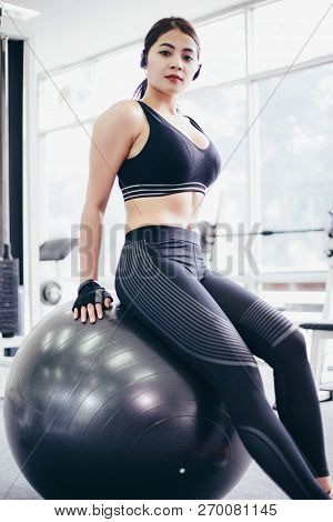 poster of Asian Women  Beautiful, Sports Girl Does Exercises On A Fitball At The Gym,soft Focus