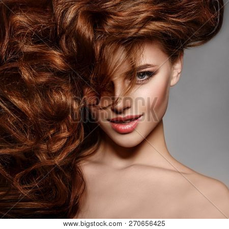 poster of Beauty Fashion Model with long shiny  hair. Waves & Curls volume Hairstyle. Hair Salon. Updo. Woman