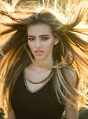 Blonde Woman With Curly Beautiful Hair. Beauty Hair Salon. Fashion Haircut. Beauty Girl With Long An poster