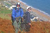 Tandem Paraglider Preparing To Launch At Beesands, Devon poster
