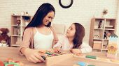 Mom Teaches Girl. Educational Games. Learning Child At Home. Cubes And Puzzles. Child Development. B poster