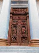 Ancient Antique Wooden Doors With Wrought Iron Loops, Massive Forged Door Handle And Cross Bars.anci poster