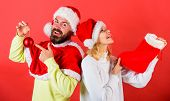 Couple Cheerful Face Check Out Gift In Christmas Sock. Christmas Gift Concept. Woman And Bearded Man poster