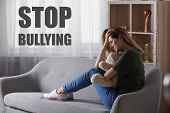 Message Stop Bullying And Sad Woman With Toy Sitting On Sofa At Home poster