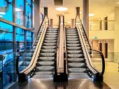 Empty Modern Stairs Or Escalators At The Modern Shopping Mall. Background Of Moving Escalator In The poster