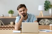 Exhausted Man Fall Asleep Near Laptop At Home Workplace poster