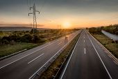 Single Car At A Beautiful Silent Countryside Motorway And Power Line At Sunset poster