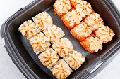 Sushi In Plastic Packaging. Baked Sushi With Flying Fish Roe. Sushi In A Plastic Box Close Up. poster