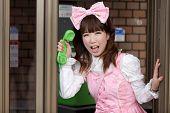 pic of lolita  - japanese girl in sweet lolita cosplay style in public phone - JPG