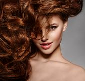 Beauty Fashion Model with long shiny  hair. Waves & Curls volume Hairstyle. Hair Salon. Updo. Woman  poster