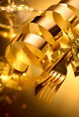 Golden cutlery, luxury Christmas table setting. Golden shiny Knife and fork on gold served table for poster