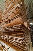 High Racks With A Parquet Board Are In The Warehouse Of Plant. Manufacturing Of A Parquet Board. Clo poster