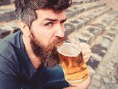 Guy Having Rest With Cold Draught Beer. Hipster On Calm Face Drinking Beer Outdoor. Draught Beer Con poster