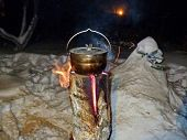 Food In The Pot Is Prepared On The taiga Candles - Logs, Coniferous Trees: Spruce, Pine, Cedar. Bu poster