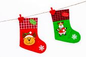 Decorative Christmas Socks. Empty Socks For Gift Hanging Off A Thread On White Background Top View poster