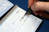 Closeup Of A Check Being Written