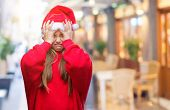 Young beautiful girl wearing christmas hat over isolated background suffering from headache desperat poster