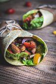 Traditional Mexican Tortilla Wrap With Vegetables And Grilled Chicken Meat On Wood Table poster