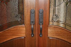 image of door-handle  - Two door handles to a large set of doors - JPG