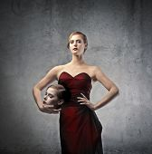 foto of beheaded  - Elegant blonde woman with her head under her arm - JPG