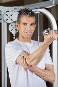 Portrait of mature man working out in fitness center