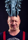 Stressed man with exploded head