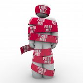 A man wrapped in red tape with the words Free Me to symbolize freedom and escaping from being trappe