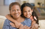 stock photo of pre-adolescents  - Grandmother and daughter hugging - JPG