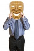 Businessman with mask concealing his identity. Mendacity concept