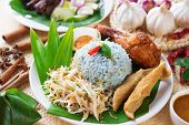 Nasi kerabu or nasi ulam, popular Malaysian Malay rice dish. Blue color of rice resulting from the p