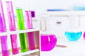 Chemistry laboratory glassware with colour liquids