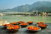 stock photo of pooja  - Puja flowers offering for the Ganges river in Rishikesh - JPG