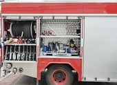 stock photo of fire brigade  - Part of equipment at one car of fire - JPG